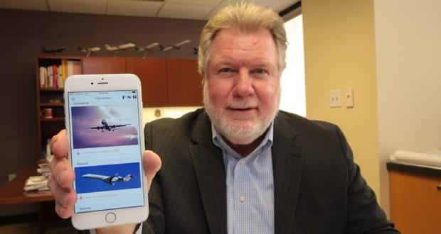Philip McNayr with FSB Architects in Oklahoma City shows the mobile phone app the firm built to aid in the design of airplane hangers.