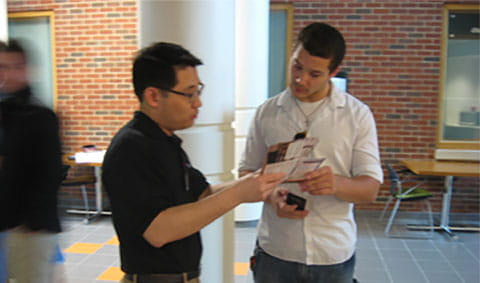 During an Interactive Workshop through the Programming/Design process for the OSU CEAT Lab, Min Koo, an FSB Associate & Senior Structural Engineer, visits with a student .