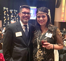 Principal Jason Holuby and his wife at the 1920s-themed FSB holiday party