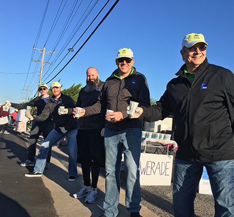 FSB employees running a water stop during the 2019 Oklahoma City Memorial Marathon