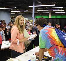 Architect Sarah Freeman judging a lego competition at the Oklahoma State Fair