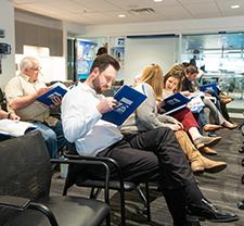 FSB employees reading the firm's 75th anniversary book written by Dr. Bob Blackburn